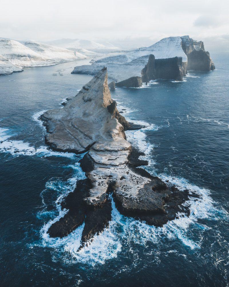 Photo of snowy cliffs in Faroe Islands