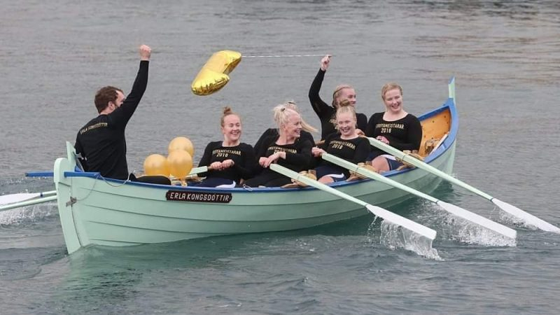Faroese people rowing